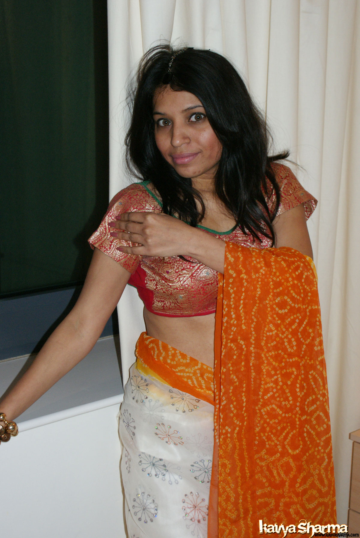 Iab picture gallery 16. Kavya in banarsi sari doing a strip show for her fans